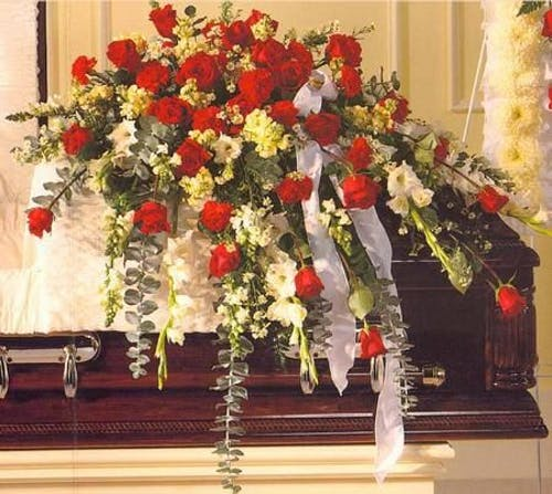 Casket Spray of Roses and Complimentary flowers
